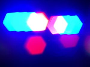 stock-footage-shot-of-blurred-police-lights-on-top-of-a-patrol-car-at-night-dv-ntsc-video